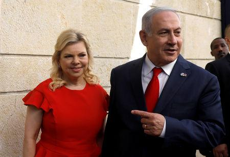 Israeli Prime Minister Benjamin Netanyahu and his wife Sara Netanyahu stand next to the dedication plaque of the U.S. embassy in Jerusalem, after the dedication ceremony of the new U.S. embassy in Jerusalem, May 14, 2018. REUTERS/Ronen Zvulun/Files