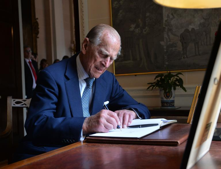 Prince Philip, the Duke of Edinburgh, signs the visitors book at Hillsborough castle in Northern Ireland, on June 25, 2014