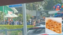 'We're doomed': Large crowd spotted queuing for free donuts at Krispy Kreme