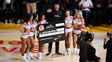 This Lakers fan (and bounty hunter) banked in a half-court shot worth $100K