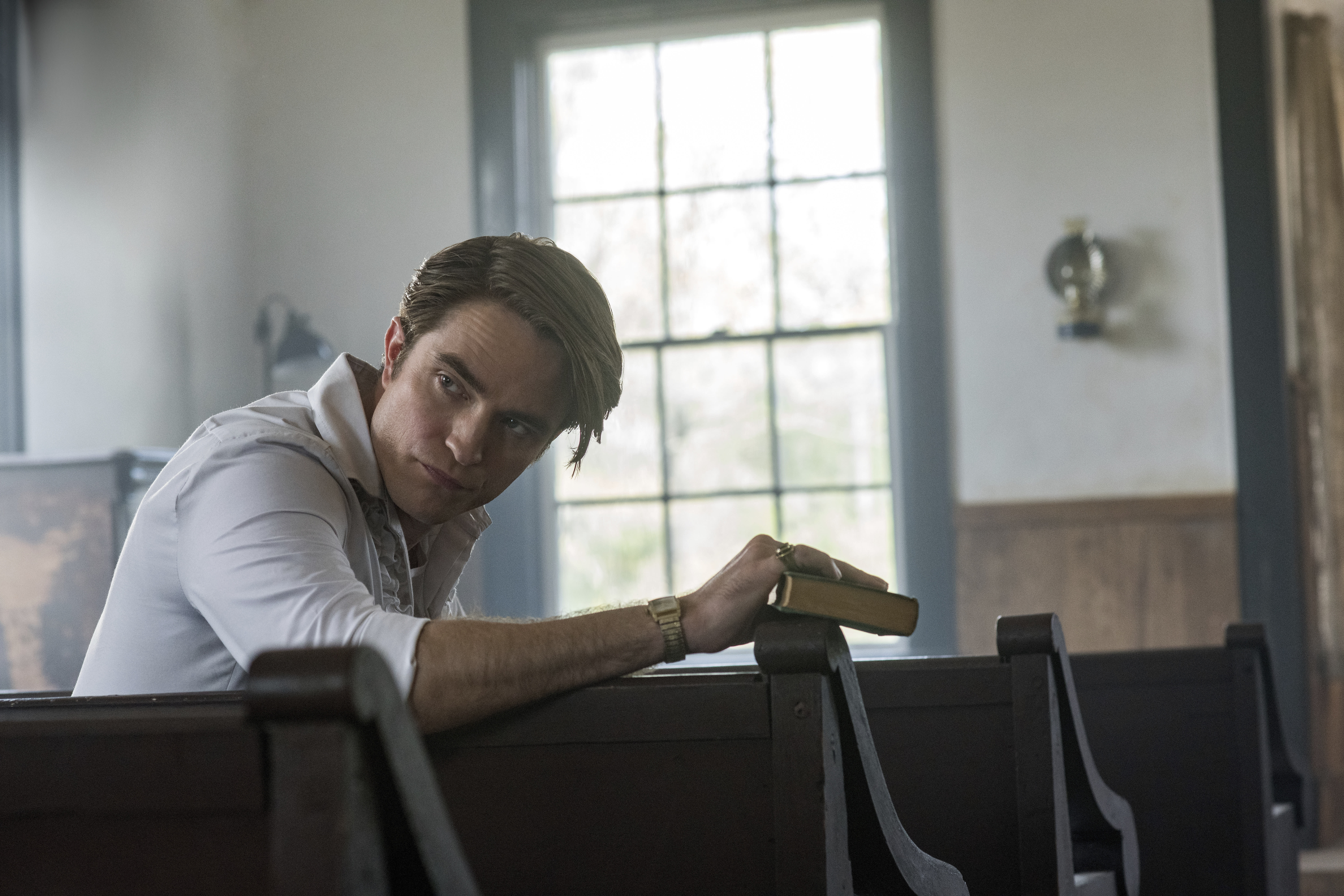"""This image released by Netflix shows Robert Pattinson in a scene from """"The Devil All The Time."""" (Glen Wilson/Netflix via AP)"""