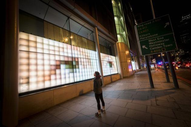 Artist uses over-sized pixels to keep an eye on London's pedestrians