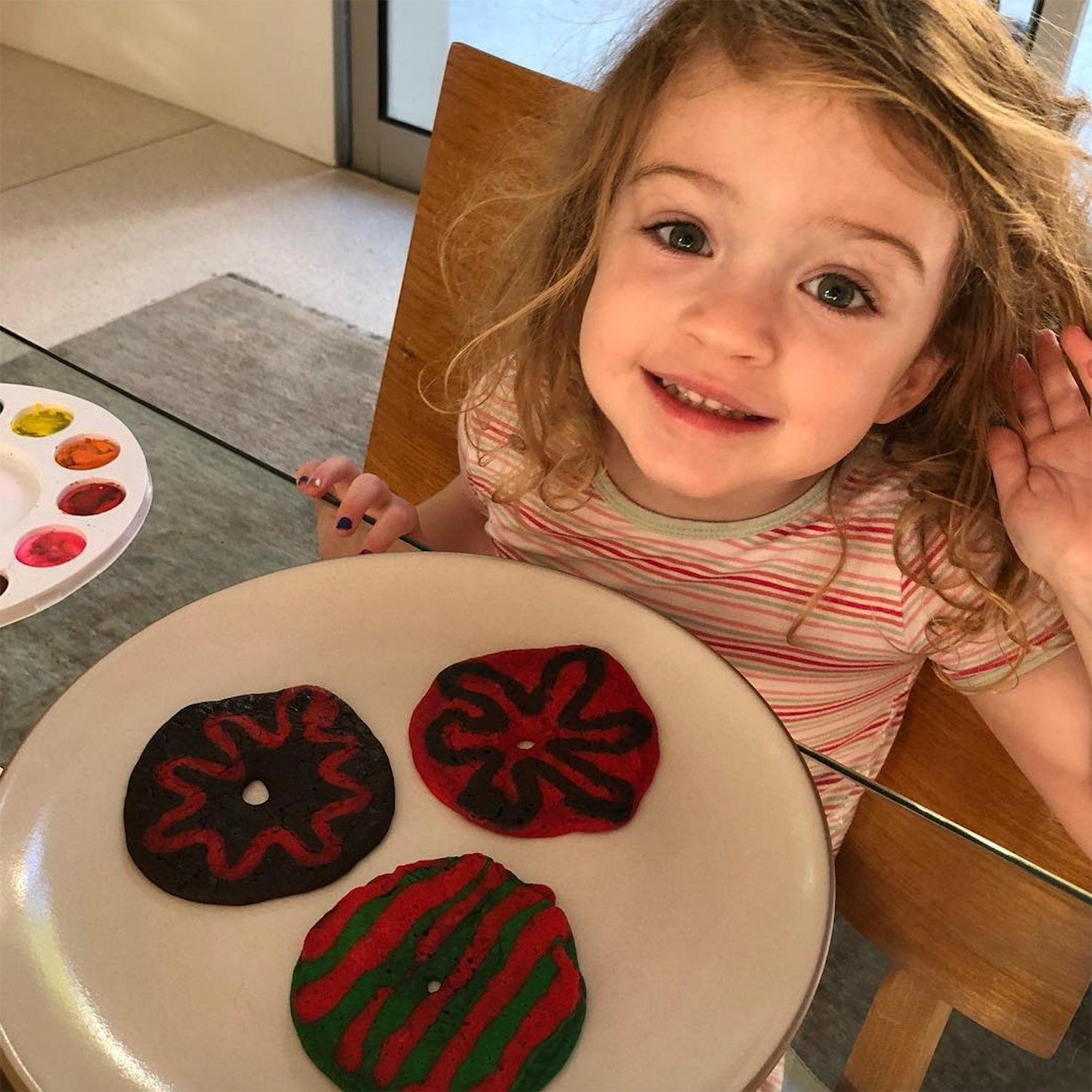 """Jane was all smiles as she prepared to dig into her dad's post-Oscars breakfast masterpiece: pancakes <a href=""""http://people.com/babies/jimmy-kimmel-pancakes-for-daughter-jane/"""" rel=""""nofollow noopener"""" target=""""_blank"""" data-ylk=""""slk:shaped and decorated like donuts"""" class=""""link rapid-noclick-resp"""">shaped and decorated like donuts</a>. """"When your 3 yr old wakes up at 6:56 am the morning after <a href=""""https://www.instagram.com/explore/tags/oscars/"""" rel=""""nofollow noopener"""" target=""""_blank"""" data-ylk=""""slk:#Oscars"""" class=""""link rapid-noclick-resp"""">#Oscars</a>, <a href=""""https://www.instagram.com/explore/tags/pancakes/"""" rel=""""nofollow noopener"""" target=""""_blank"""" data-ylk=""""slk:#pancakes"""" class=""""link rapid-noclick-resp"""">#pancakes</a> disguised as <a href=""""https://www.instagram.com/explore/tags/donuts/"""" rel=""""nofollow noopener"""" target=""""_blank"""" data-ylk=""""slk:#donuts"""" class=""""link rapid-noclick-resp"""">#donuts</a>,"""" wrote the late-night personality — who hosted last year's show — next to <a href=""""https://www.instagram.com/p/Bf8mejJH4G9/"""" rel=""""nofollow noopener"""" target=""""_blank"""" data-ylk=""""slk:the cute photo"""" class=""""link rapid-noclick-resp"""">the cute photo</a>."""