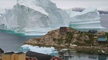 Incredible photo shows 'iceberg tsunami' threat against tiny village