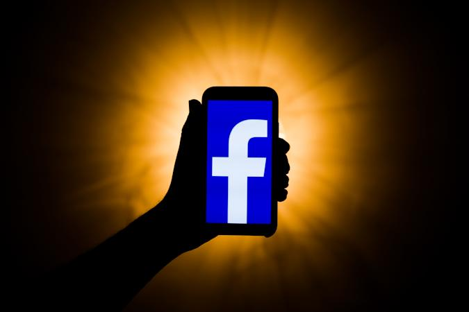 In this photo illustration the Facebook logo is seen displayed on smartphone screen in this illustration photo taken in Poland on February 19, 2020. (Photo by Jakub Porzycki/NurPhoto via Getty Images)