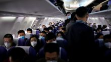 China to significantly reduce international flights amid virus concerns