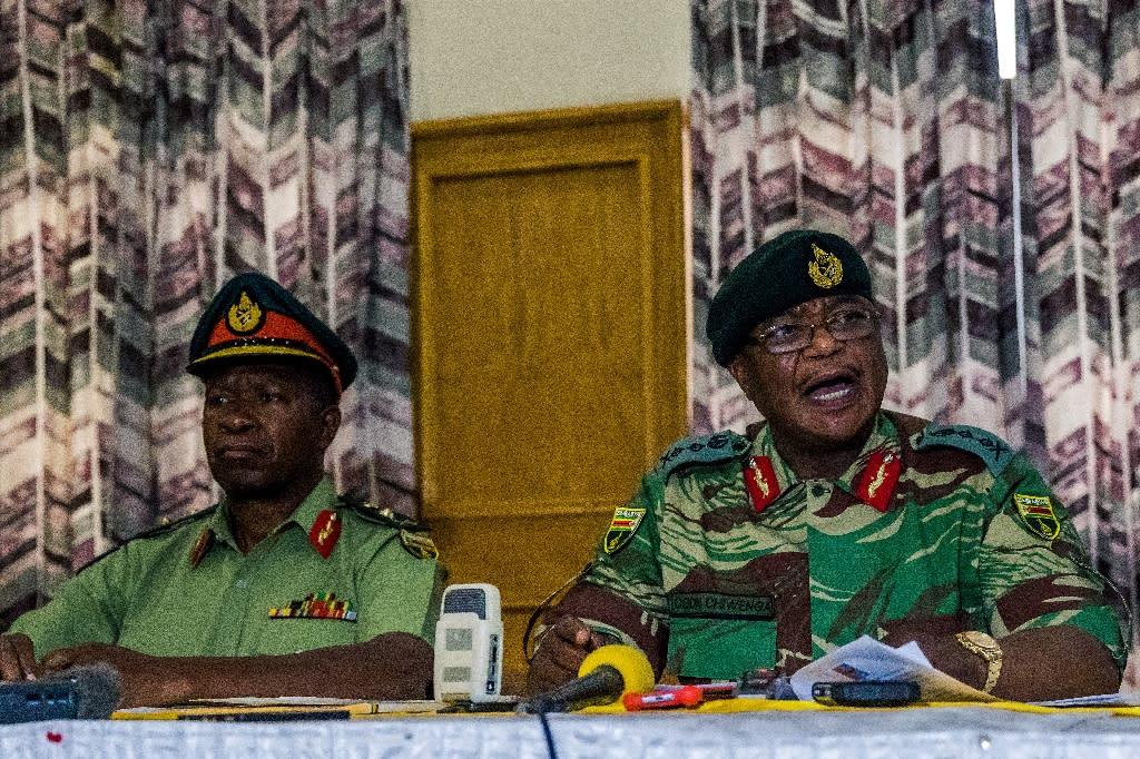 Zimbabwe Army chief Constantino Chiwenga (right) addresses a media conference in Harare on November 13, 2017 (AFP Photo/Jekesai NJIKIZANA)