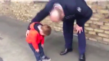 Watch: Little boy is so overcome at seeing his soldier dad again that he can't move