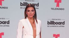 Eva Longoria Never Wears Shirts With Her Pantsuits
