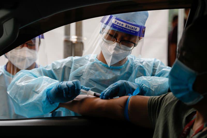 Philippines reports 29 new coronavirus deaths, 2,498 infections