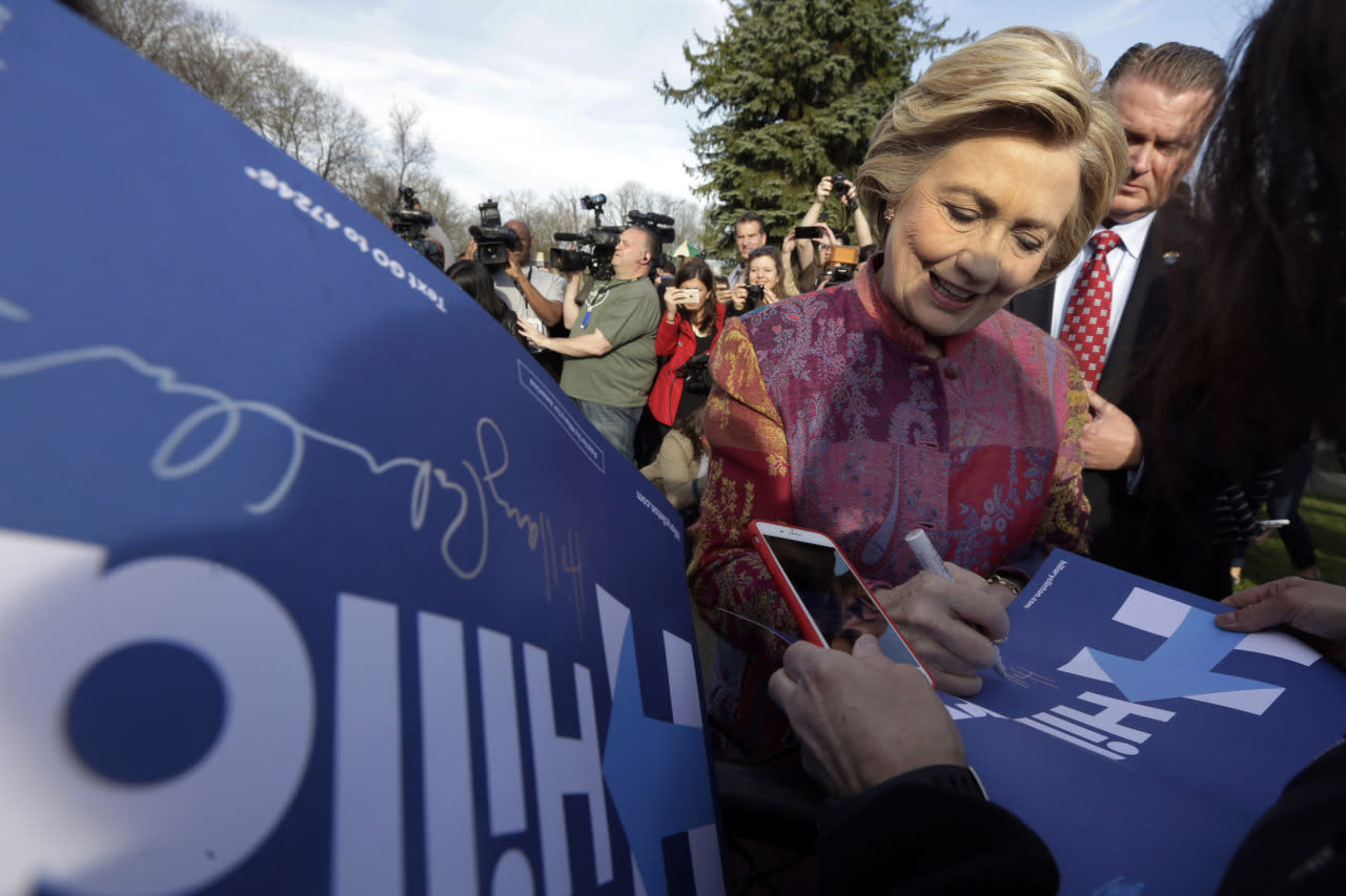 <p>Democratic presidential candidate Hillary Clinton signs autographs after voting at the Grafflin Elementary School in Chappaqua, N.Y., Tuesday, April 19, 2016. <i>(Photo: Richard Drew/AP)</i></p>