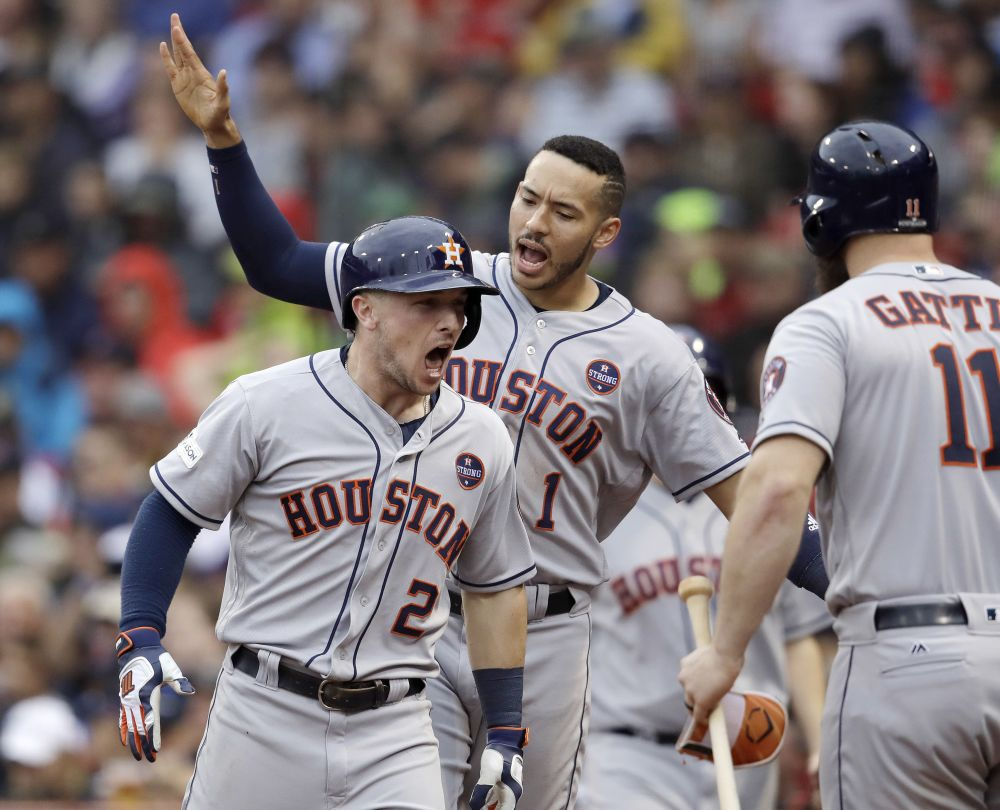 Alex Bregman (No. 2) celebrates his home run during the eighth inning of Game 4 in the ALDS. He was one of several Astros offensive heroes in the series. (AP)