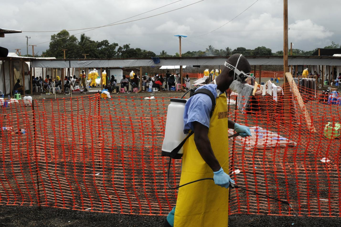 A health care worker disinfects around the high-risk area at Elwa hospital, run by Medecins Sans Frontieres, in Monrovia on August 30, 2014