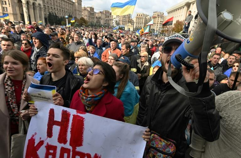 The protesters said that agreeing to give broader autonomy to the separatist territories would mean surrendering Ukraine's interests (AFP Photo/Genya SAVILOV)