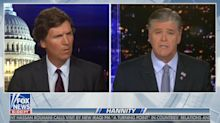 Hannity refutes Carlson's Bezos argument, then apologizes after awkward interaction