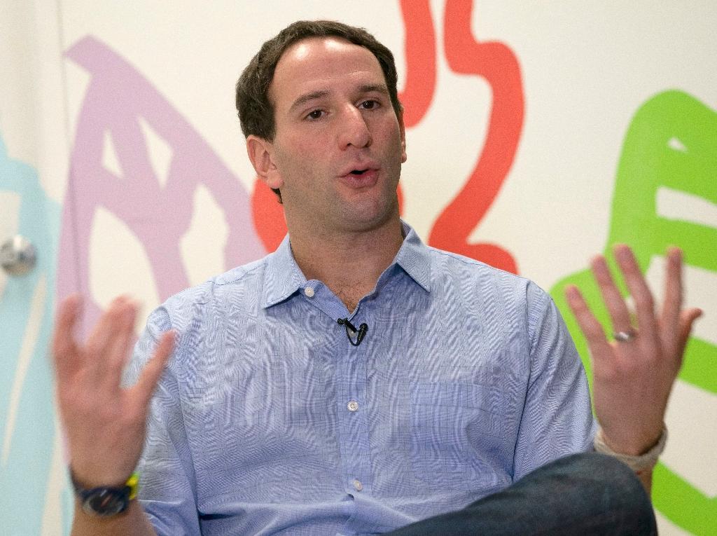 Irving Fain, CEO and co-founder of Bowery Farming, talks about his hydroponic grown greens (AFP Photo/Don EMMERT)