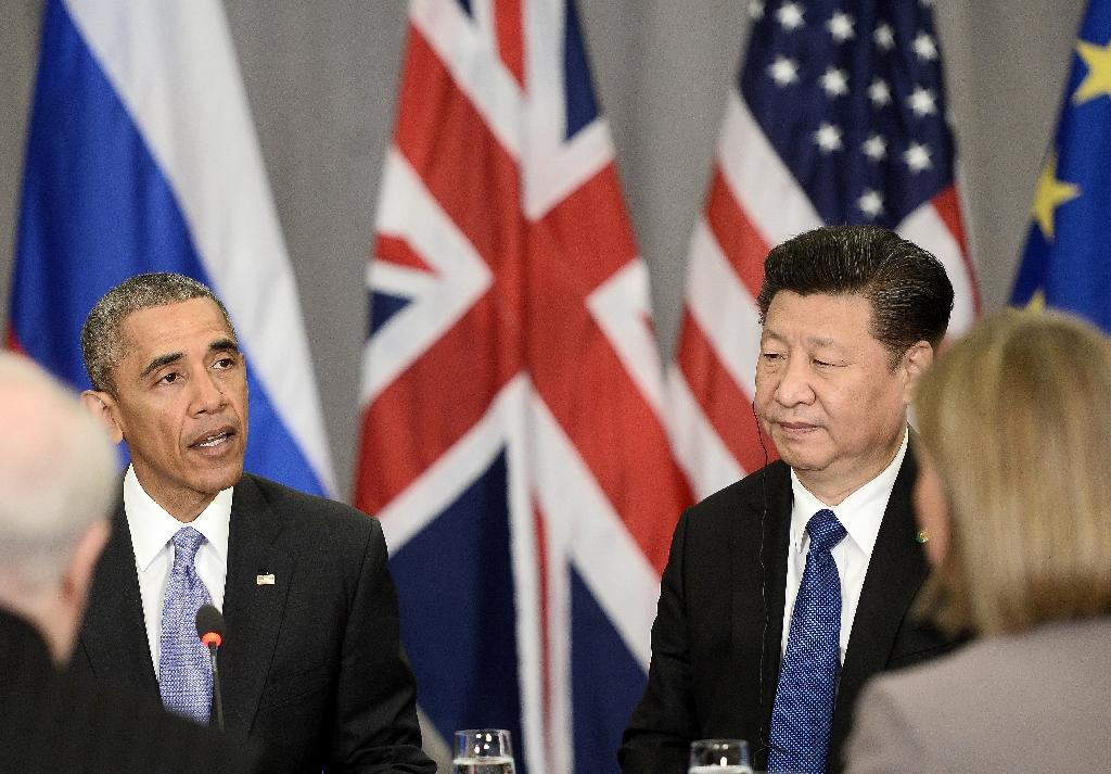 China's President Xi Jinping (R) alongside US President Barack Obama (L) at a Nuclear Security Summit meeting in April in Washington, DC (AFP Photo/Stephane De Sakutin)