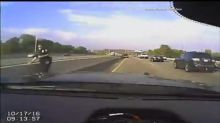 Police Dash Cam Catches High-Speed Collision During Traffic Stop