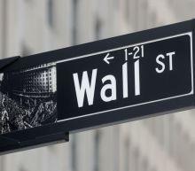 Stocks mostly rise but Nasdaq falls; dollar backs off two-week high