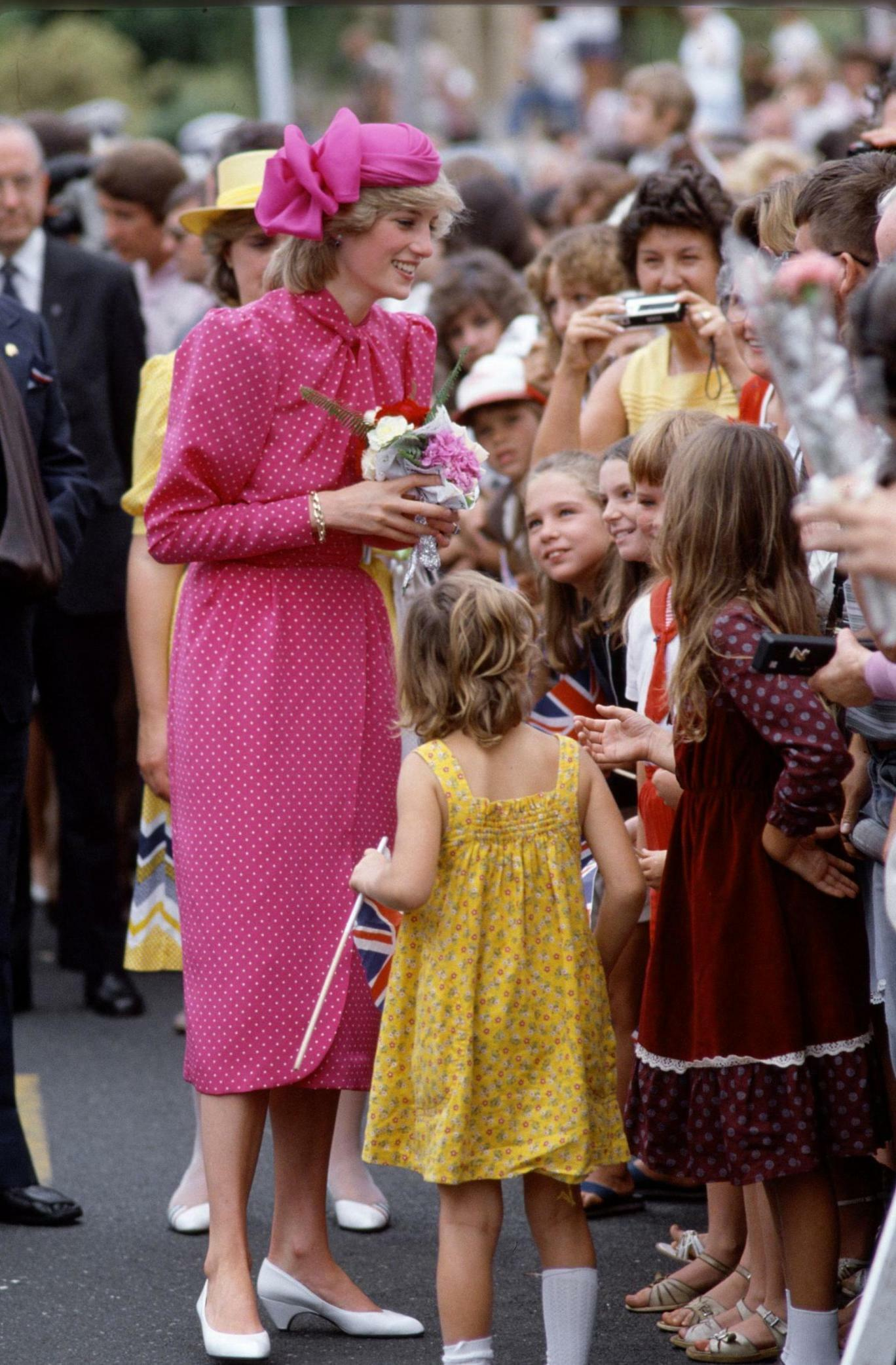 Diana poses for pictures with members of the public during a walkabout.