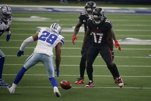 Dallas Cowboys cornerback C.J. Goodwin (29) follows on Cowboys onside kick as Atlanta Falcons' Olamide Zaccheaus (17) looks on in the second half of an NFL football game in Arlington, Texas, Sunday, Sept. 20, 2020. Goodwin recovered the kick. (AP Photo/Ron Jenkins)