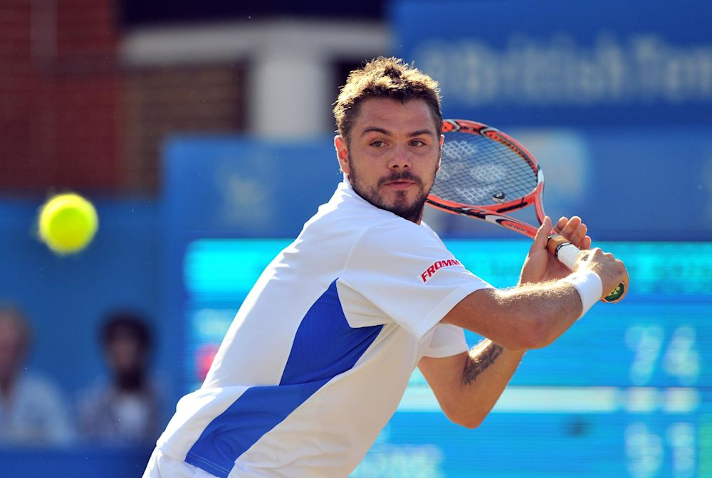 Switzerland''s Stan Wawrinka plays a shot during his quarter-final match against Australia''s Marinko Matosevic (unseen) during the Aegon Championships at Queen's Club in west London, on June 13, 2014