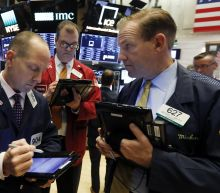Markets Right Now: Banks lead US indexes lower; tech gains