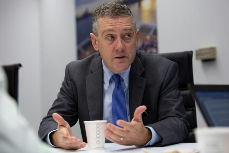 Federal Reserve Bank President James Bullard speaks during an interview with AFP (AFP Photo/Alastair Pike)