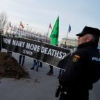 Frustrated with climate talks, activists dump manure outside Madrid summit