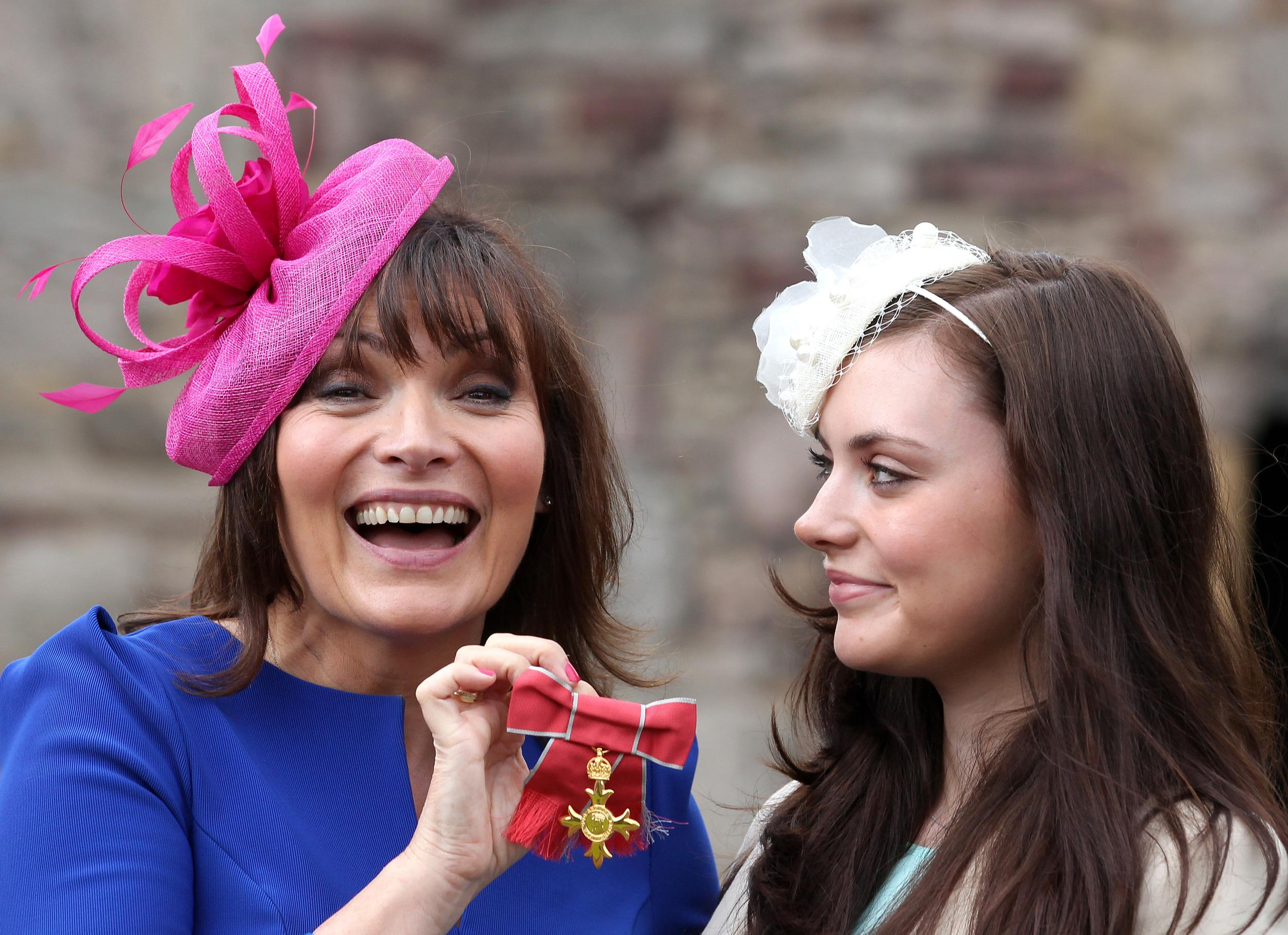 TV presenter Lorraine Kelly with her daughter Rosie after she was awarded an OBE by Queen Elizabeth II for services to charity and armed forces at a ceremony at The Palace of Holyroodhouse in Edinburgh.