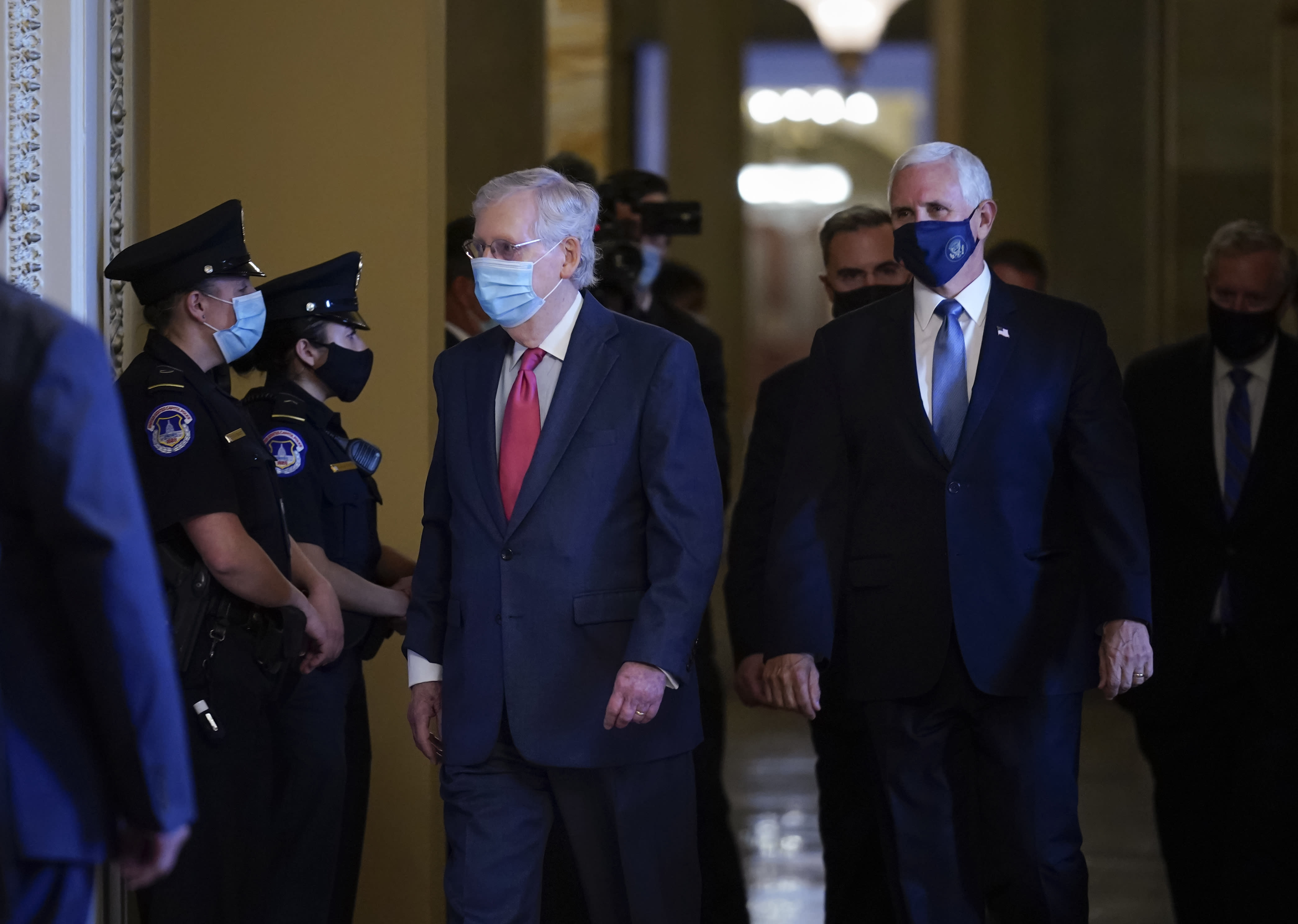 Senate Majority Leader Mitch McConnell, R-Ky., left, and Vice President Mike Pence, right, walk to hold a private meeting with Judge Amy Coney Barrett, President Donald Trump's nominee for the U.S. Supreme Court, at the Capitol in Washington, Tuesday, Sept. 29, 2020. (AP Photo/J. Scott Applewhite)