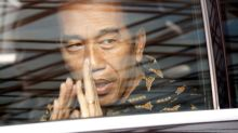 Indonesian president's lead over election rival cut in new survey