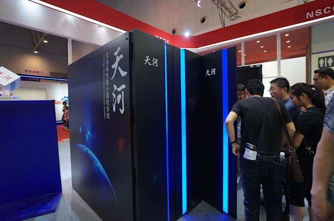 TIANJIN, CHINA - MAY 19:  Visitors watch the prototype of Chinese supercomputer Tianhe-3 at World Intelligence Expo as part of the 2nd World Intelligence Congress (WIC 2018) on May 19, 2018 in Tianjin, China. The 2nd World Intelligence Congress (WIC 2018) centering on changes and opportunities brought by AI technologies will be held from May 16 to 18 in Tianjin.  (Photo by Visual China Group via Getty Images/Visual China Group via Getty Images)