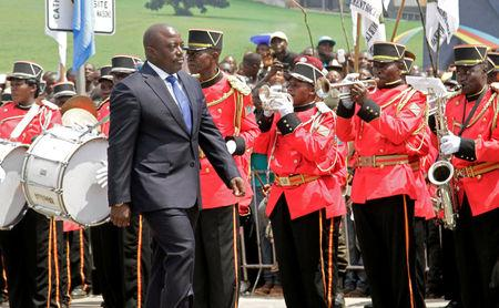 Democratic Republic of the Congo's President Joseph Kabila inspects a guard of honour during the anniversary celebrations of CongoÕs independence from Belgium in Kindu, the capital of Maniema province in the Democratic Republic of Congo, June 30, 2016. REUTERS/Kenny Katombe/File Photo
