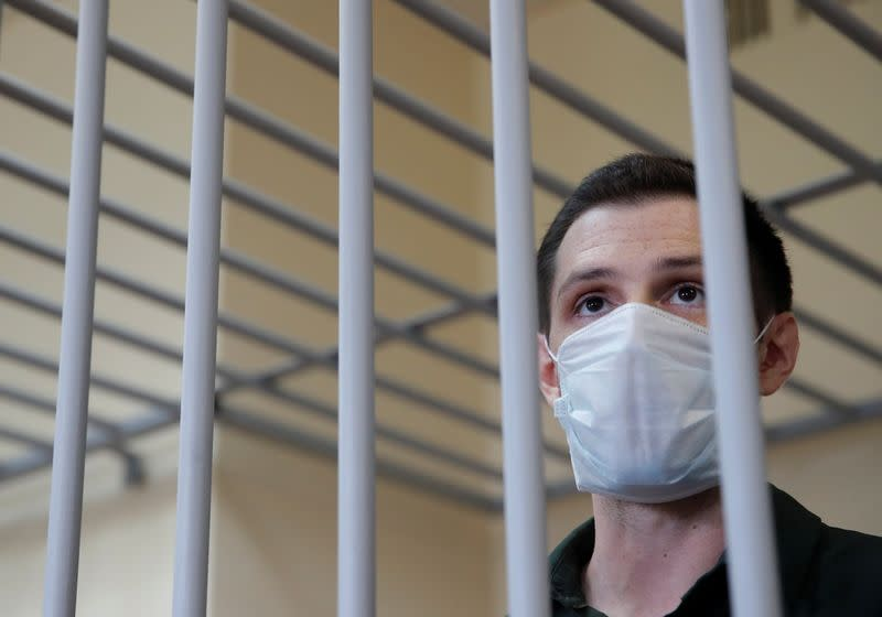 Russia jails former U.S. Marine for nine years on police assault charge