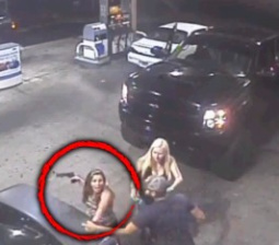 Woman Climbs Out of Truck Brandishing Gun in Shocking Road Rage Video