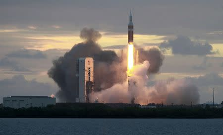 The Delta IV Heavy rocket with the Orion spacecraft lifts off from the Cape Canaveral Air Force Station in Cape Canaveral