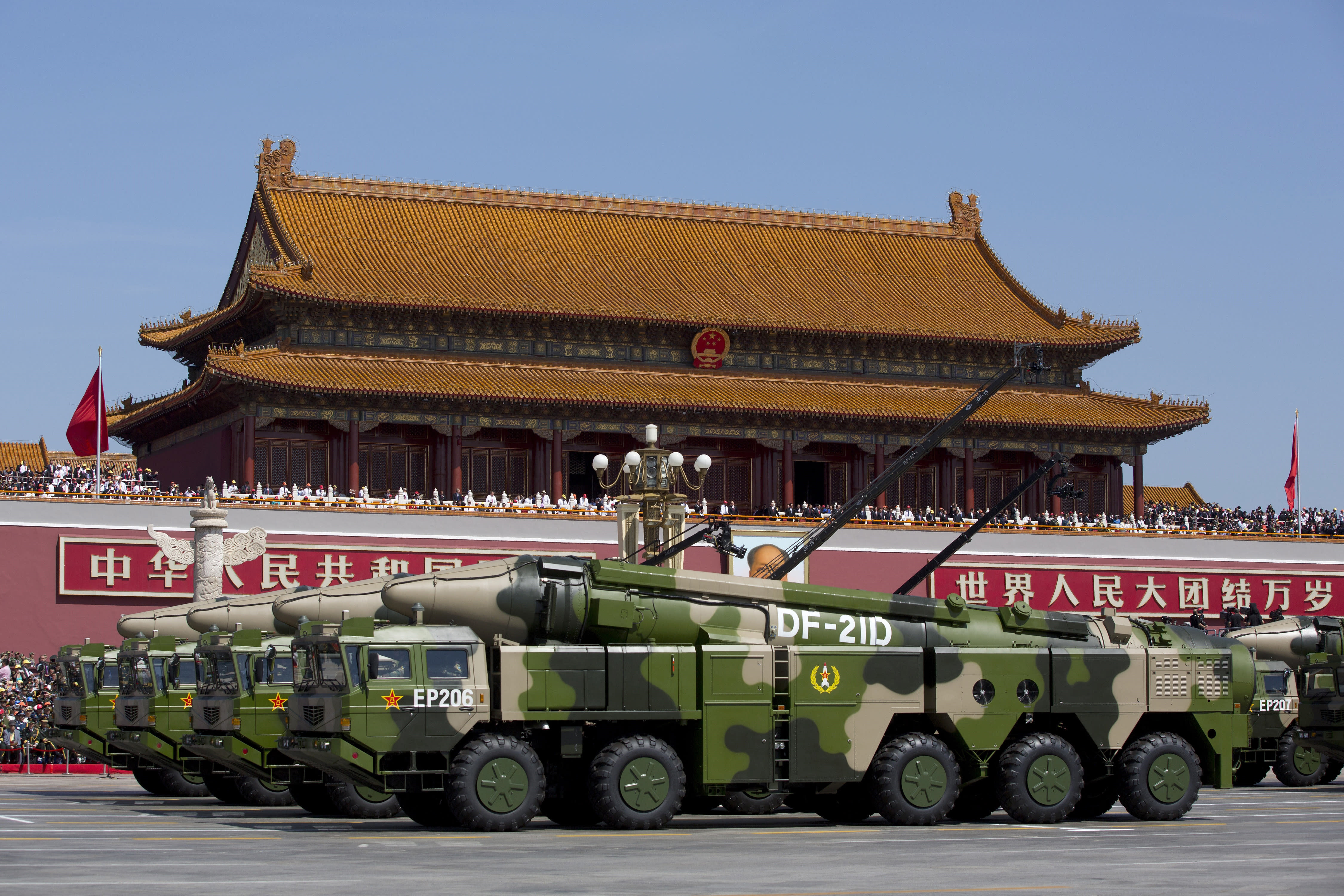 """FILE - In this Sept. 3, 2015, file photo, Chinese military vehicles carrying DF-21D anti-ship ballistic missiles, potentially capable of sinking a U.S. Nimitz-class aircraft carrier in a single strike, pass by Tiananmen Gate during a military parade to commemorate the 70th anniversary of the end of World War II, in Beijing. China's military test-fired two missiles into the South China Sea, including a """"carrier killer"""" military analysts suggest might have been developed to attack U.S. forces, a newspaper reported Thursday, Aug. 27, 2020. (AP Photo/Andy Wong, Pool, File)"""