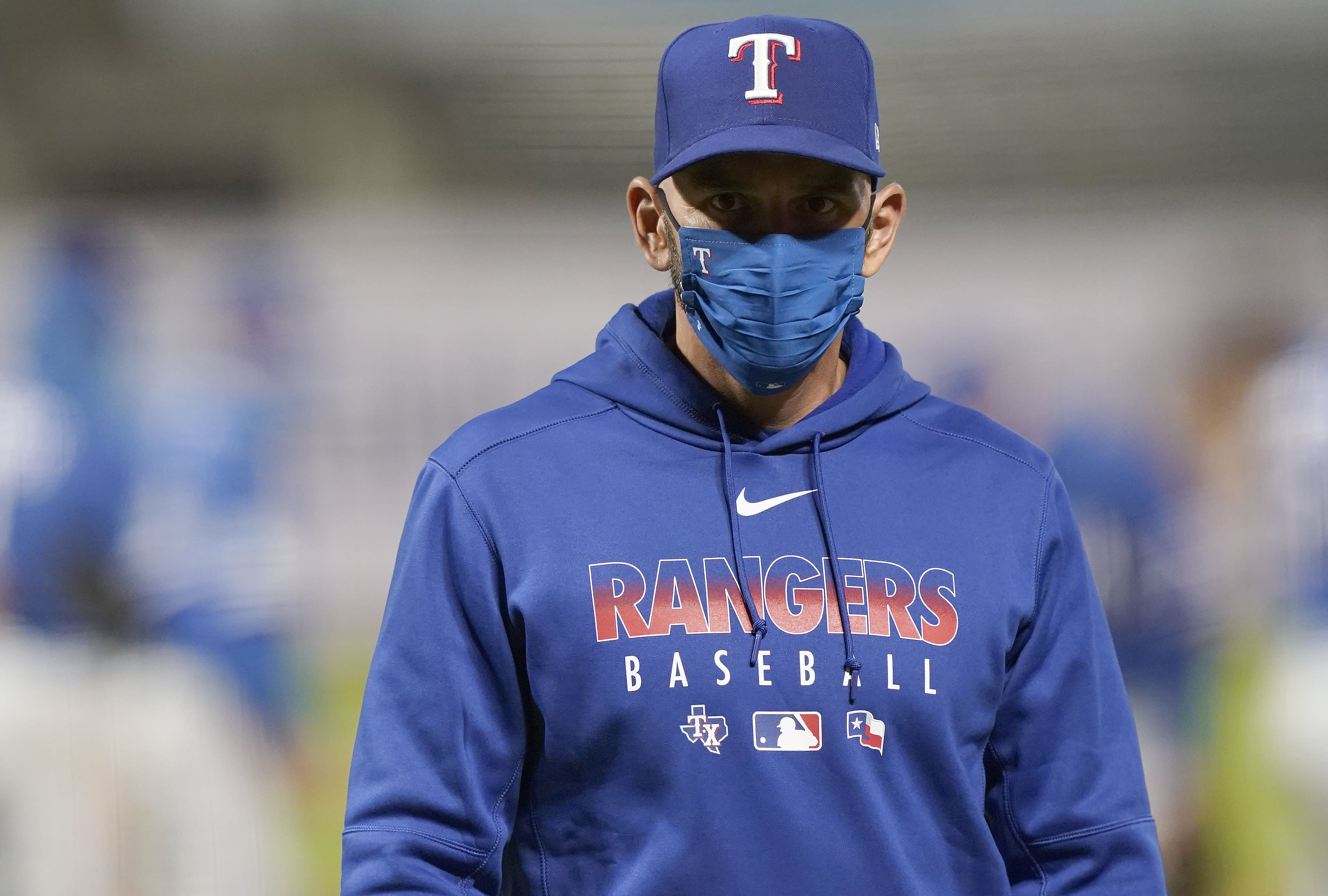 MLB suspends Rangers manager Chris Woodward, pitcher Ian Gibaut for throwing behind Manny Machado