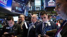 S&P 500 y Dow cierran en baja tras moderado comunicado de la Fed