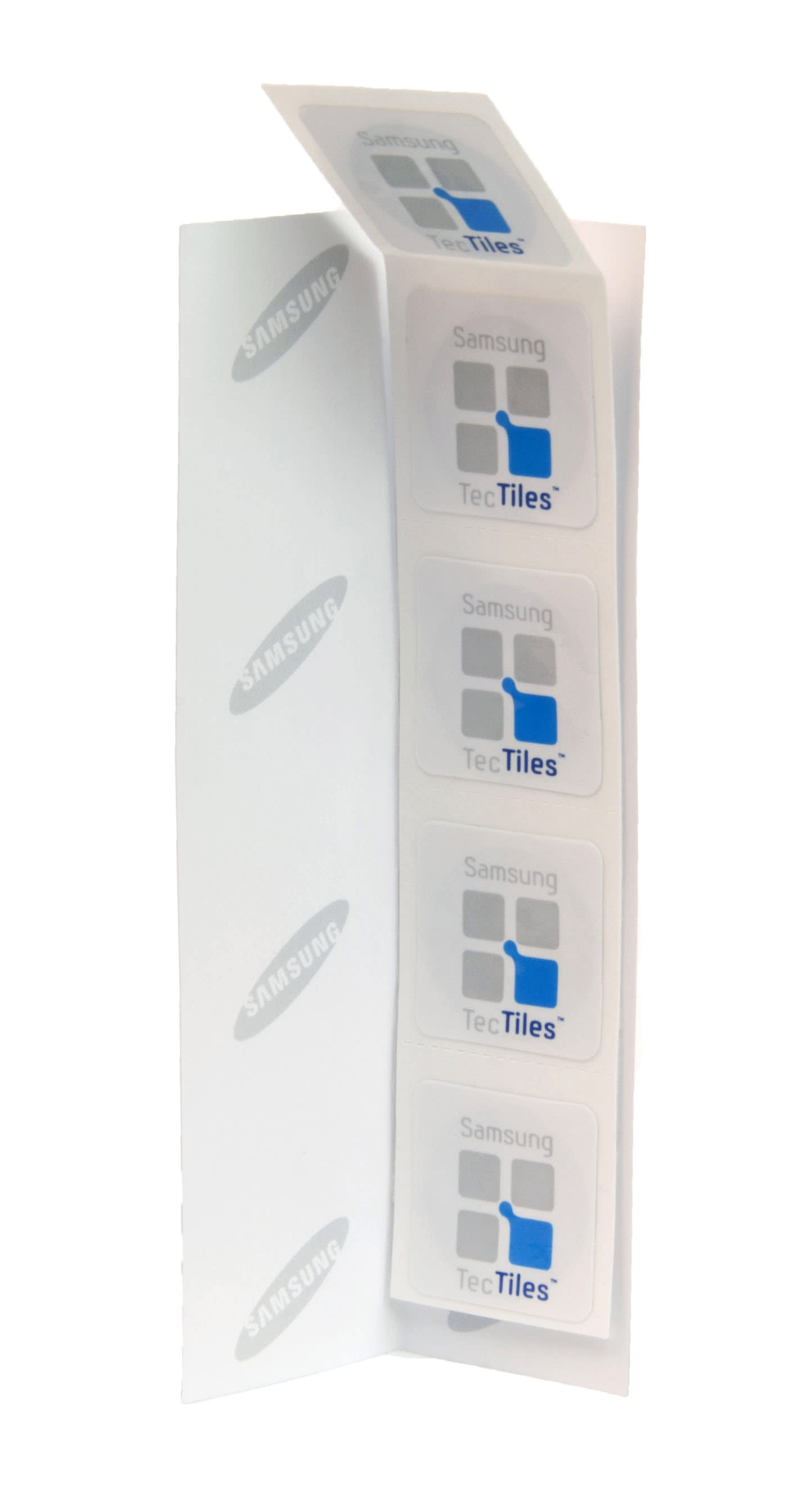 This undated image provided by Samsung on Friday, June 15, 2012 shows TecTiles stickers for use with certain near field communications-enabled mobile phones. The big push behind the technology comes from companies that see the phone as the wallet of the future. When touched to payment terminals, NFC-equipped phones can act as credit or debit cards. (AP Photo/Samsung)