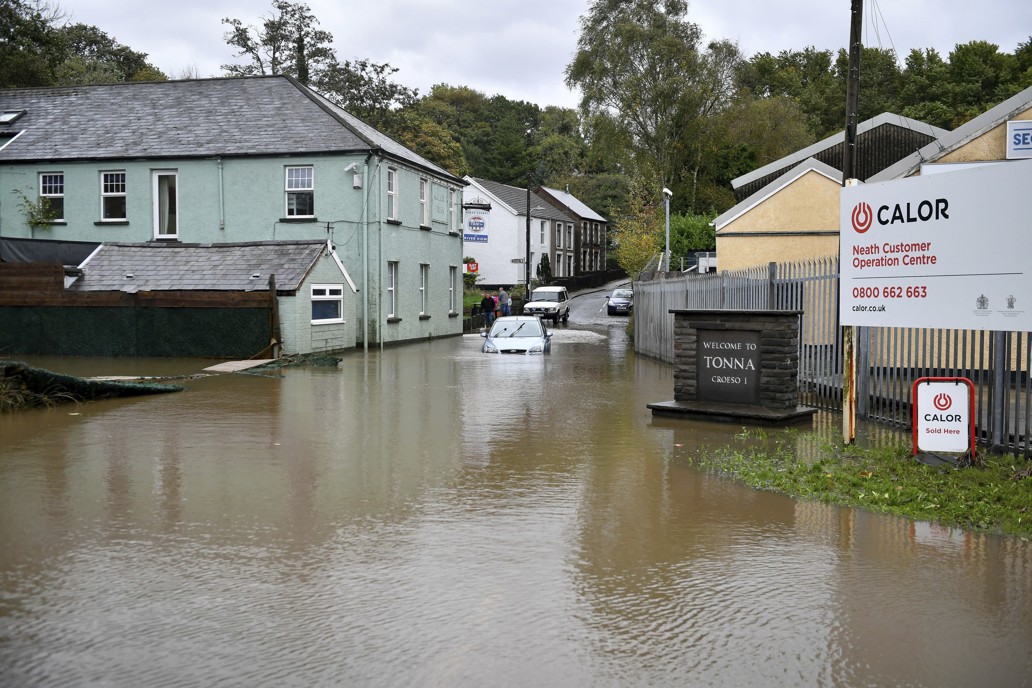 A car is stranded in floodwater where an amber weather warning is in force across the region, in Tonna near Aberdulais, Neath, in South Wales, Saturday, Oct. 13.2018. (Ben Birchall/PA via AP)