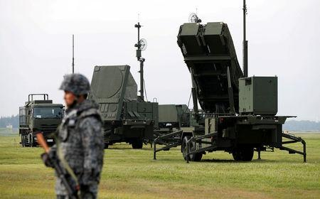 FILE PHOTO : A Japan Self-Defense Forces (JSDF) soldier takes part in a drill to mobilise their Patriot Advanced Capability-3 (PAC-3) missile unit in response to a recent missile launch by North Korea, at U.S. Air Force Yokota Air Base in Fussa on the outskirts of Tokyo, Japan August 29, 2017. REUTERS/Issei Kato/File Photo