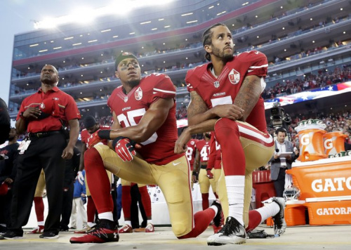Colin Kaepernick, shown here with 49ers safety Eric Reid, kneeled during the national anthem last season to bring attention to social injustice. (AP)