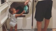 1-year-old girl helps dad with laundry in adorable video