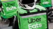 Uber rides demand takes COVID-19 hit but food-delivery business doubles
