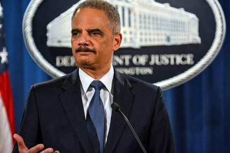 Then U.S. Attorney General Eric Holder addresses a Justice Department news conference in Washington, March 2015. REUTERS/James Lawler Duggan