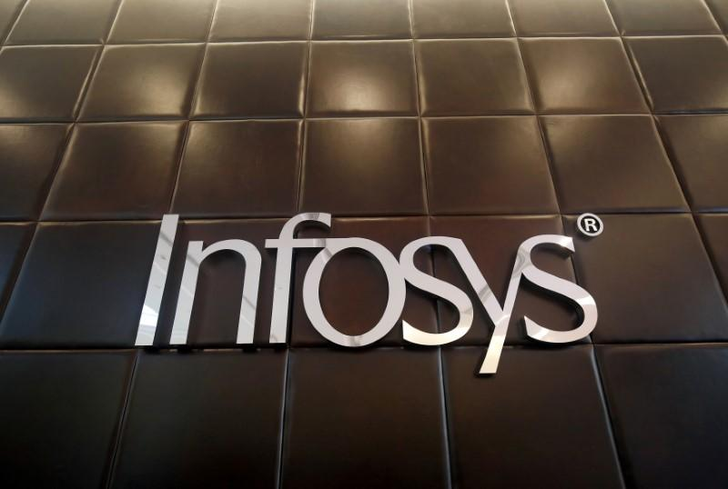 FILE PHOTO: The logo of Infosys is pictured inside the company's headquarters in Bengaluru