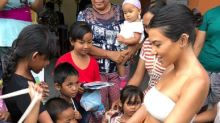 Kourtney Kardashian is being shamed for wearing a crop top while visiting kids at a school in Bali