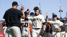 Giants hit 3 HRs, Gausman solid in 7-1 win over Padres
